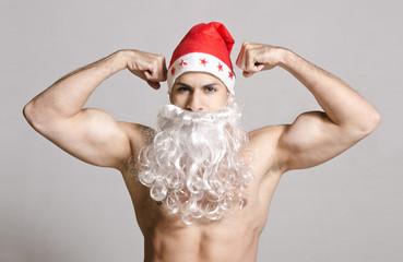 Strong Santa posing in studio shot