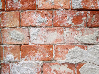 Rough red brick wall background texture