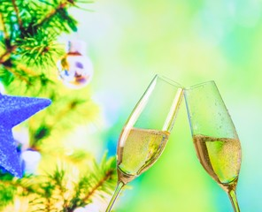 champagne flutes on christmas tree decoration background