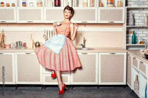Woman in the kitchen. - 74493019