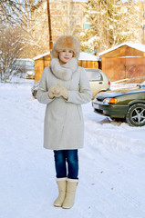 Full length portrait of a girl in winter day