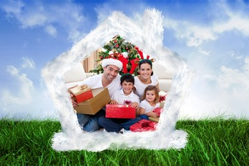 Composite image of happy family celebrating christmas at home