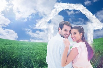 Composite image of attractive young couple smiling at camera