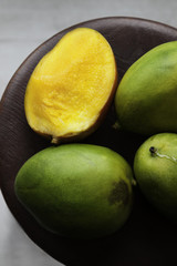 Ripe mangoes on the wooden table