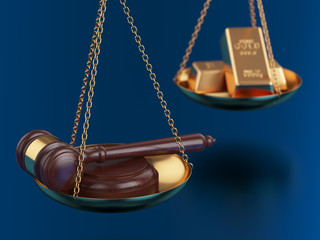 Gold bars with wooden gavel on the scales