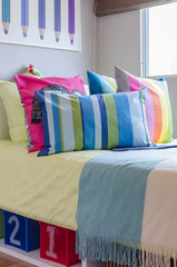 colorful pillows in kid bedroom at home