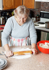Senior woman rolling dough