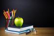 Teacher's desk with a color pencil, notebook