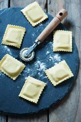 Homemade italian ravioli on the wooden table