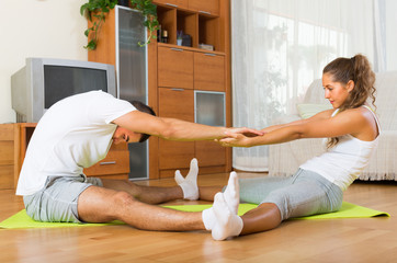 Young couple doing  exercises together