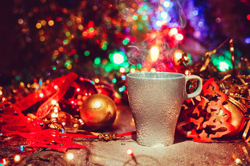 Cup of tasty hot cocoa, on wooden table, with shiny background