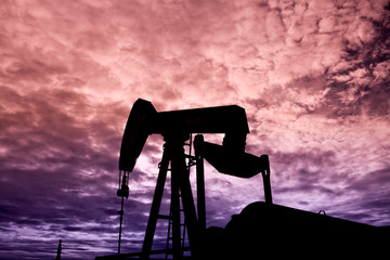Silhouetted Pumpjack at Sunset