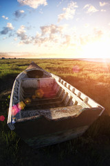 View of an old abandoned fishing boat on the marshlands.