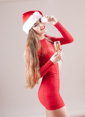 Santa pretty girl  with glass of champagne.