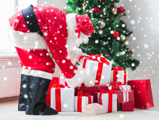man in costume of santa claus with presents