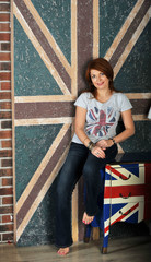 girl sitting on the nightstand on the English flag background