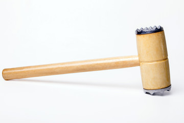Close up view of a meat hammer isolated on a white background.