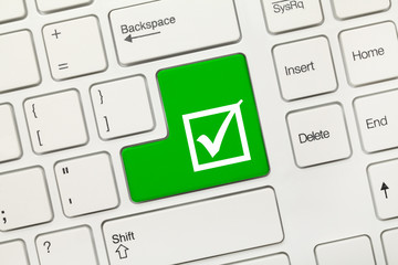 White conceptual keyboard - Checkbox with tick (green key)