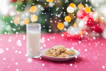 close up of cookies and milk glass on table