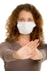 Girl wearing facemask gesture forbidden