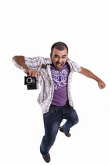 happy man jumping with a camera