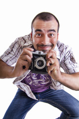 young happy man jumping with a camera