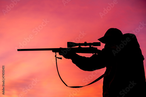 Foto op Canvas Jacht Hunter Shooting at Sunrise