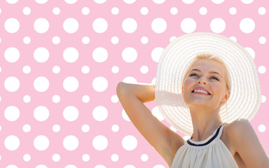 beautiful smiling woman in white summer hat