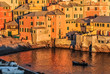Warm atmosphere during the sunset in Boccadasse (sea district of Genoa)