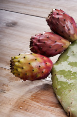 Ripe Prickly pear or paddle cactus and red fruit.