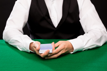 holdem dealer with playing cards