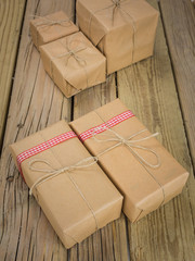 string and brown paper parcels decorated with ribbon