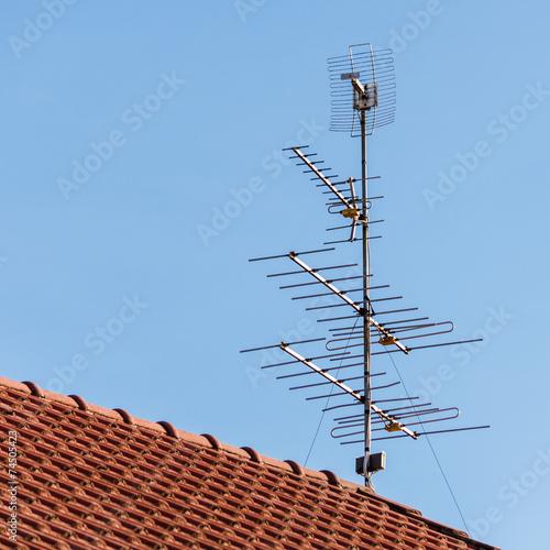 Leinwandbild Motiv television antenna  on roof