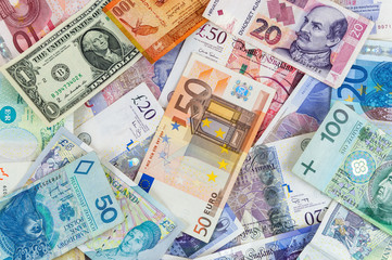Different currencies banknotes background