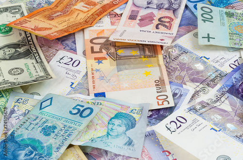 Different currencies banknotes background - 74505678