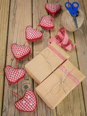 string and brown paper parcels with scissors, string, ribbon  an