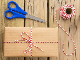 string and brown paper parcel with scissors and string