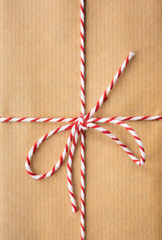 string bow against brown paper