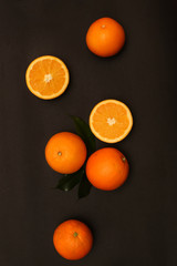 Group of oranges on the black background
