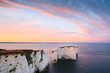Chalk cliffs and Old Harry rocks in eastern Dorset, UK.