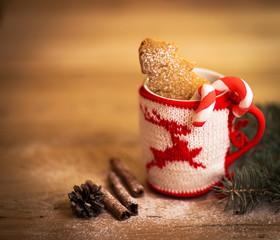 Christmas mug with decorations and sweets