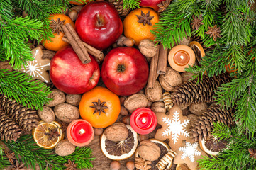 Christmas food backdround. Fruits, cookies, spices and nuts