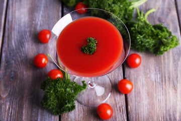 Tomato juice in goblet, parsley and fresh tomatoes