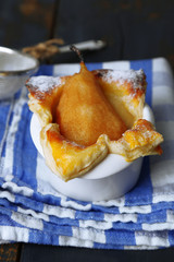 Small pear pie in cup, close up
