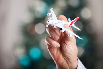 Closeup of man hand holding model of airplane