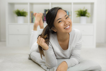Portrait of Chinese female with perfect smile and skin