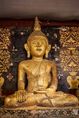 Old antique statue of Buddha in a temple room. Thailand