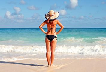 Young Woman in bikini on the beach.