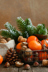 Xmas decoration with tangerines and nuts with copyspace on woode