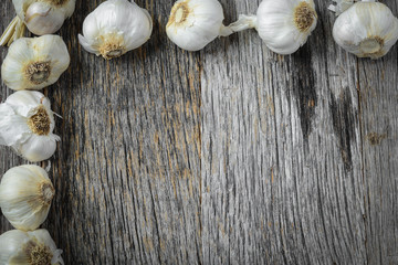 Garlic on Rustic Wood Background
